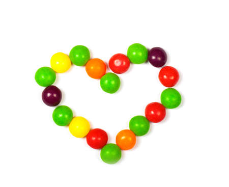 smarties: Heart made of colored smarties on a white background.