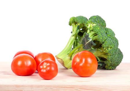 viability: broccoli and tomatoes isolated on wooden table