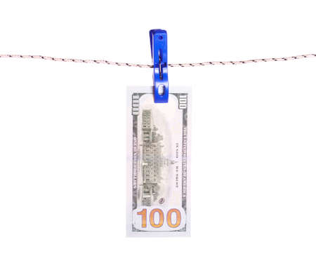 clothes pins: Dollar bills hanging on rope attached with clothes pins. Money-laundering concept.
