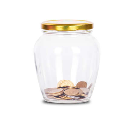 Coins in glass money jar, on white background
