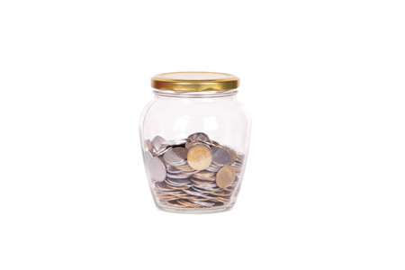 money jar: Coins in glass money jar, on white background