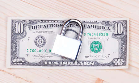 bank activities: Safe secure chain locked stack of hundred dollar bills