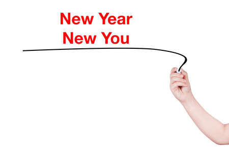 highlighter pen: New Year New You word write on white background by woman hand holding highlighter pen