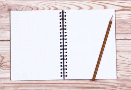 blank note book: brown blank note book on grunge wood Stock Photo