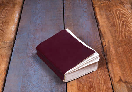 exorcism: Holy Bible on old wooden church table, top view