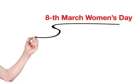 highlighter pen: 8-th March womens day word write on white background by woman hand holding highlighter pen