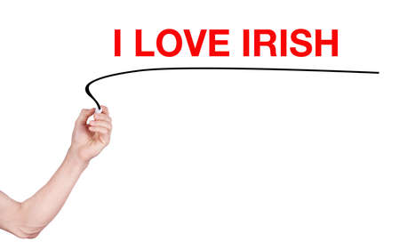 irish woman: I love Irish word write on white background by woman hand holding highlighter pen Stock Photo