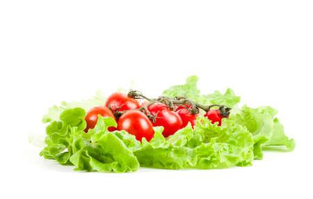 cornsalad: cherry tomato and lettuce on a white background