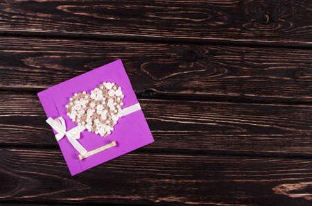 ephemera: Violet postcard on a wooden board Stock Photo