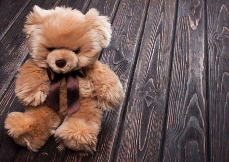 soft background: teddy bear on a wooden board Stock Photo