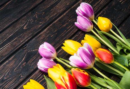 birthday background: Bouquet tulip on wood background