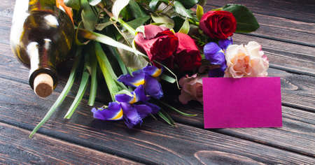 purple  love: Tulips and a card on a wooden background