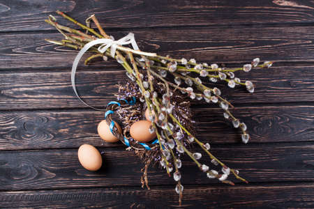 straw twig: Easter eggs and young willow branches Stock Photo