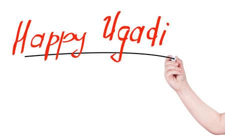 marathi: Happy ugadi word write on white background by woman hand holding highlighter pen