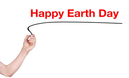 observance: Happy earth day word on white background by woman hand holding highlighter pen Stock Photo