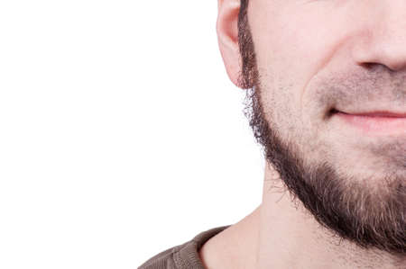 metrosexual: Perfect beard. Close-up of young bearded man standing against white background Stock Photo