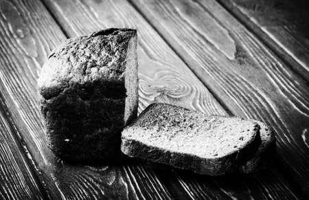 whole grain: whole grain bread isolated on wood desk