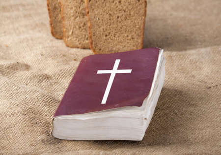 sack cloth: Bible and bread on a sack cloth
