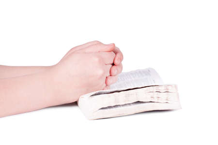 intercede: Hands praying person on the Bible Stock Photo