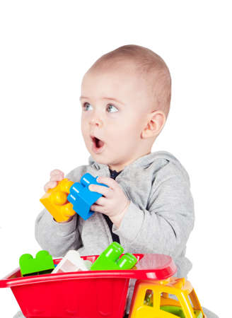 constructor: child plays with plastic constructor on white background Stock Photo