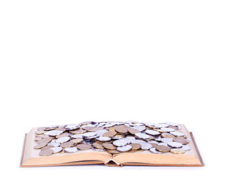 richer: A big open book with coins. Reading makes you richer- concept. Isolated on white.
