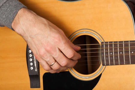 Mans Hand Playing The Guitar Setting A Chord On The Guitar Stock