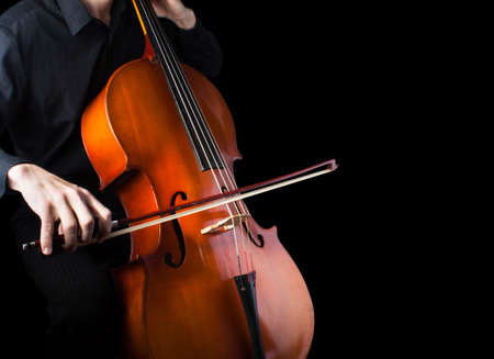 soloist: Man playing the cello.