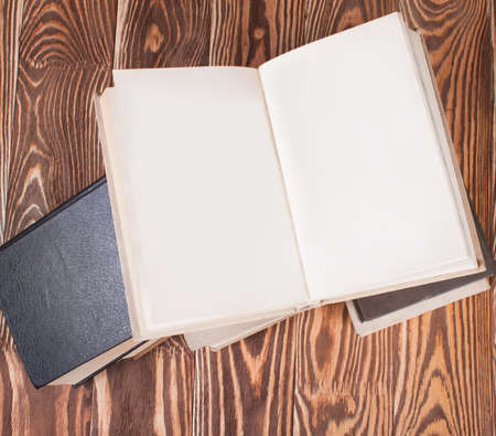 untidiness: Old books on wood desk