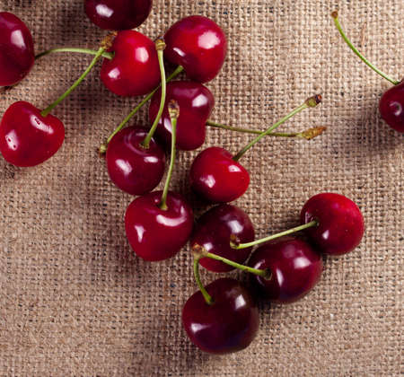 sack cloth: Cherry isolated on sack cloth. Fresh cherry
