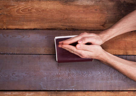 intercede: The prayer on the Bible. Hands on the Bible Stock Photo