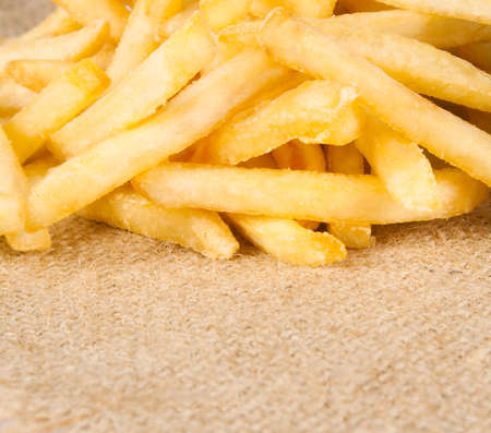 sack cloth: pile of appetizing french fries on sack cloth Stock Photo