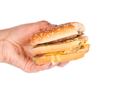 full face: Burger full face with vegetables in female hand.  Meat hamburger. Stock Photo