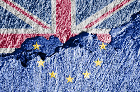 skepticism: brexit blue european union EU flag on broken wall and half great britain flag