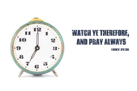 intervene: The clock and the words from the Bible Watch ye therefore, and pray always. Stock Photo