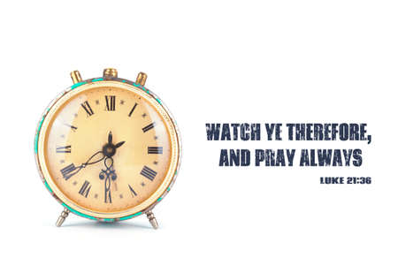 The clock and the words from the Bible Watch ye therefore, and pray always. Stock Photo