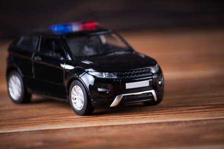tight focus: Small police car on wooden boards