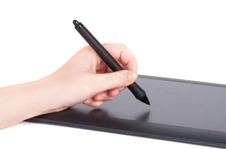 digitized: Hand is drawing on a digital graphic tablet with pen