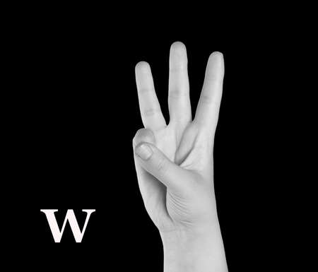 asl: The Letter W. Finger Spelling the Alphabet in American Sign Language (ASL). Stock Photo