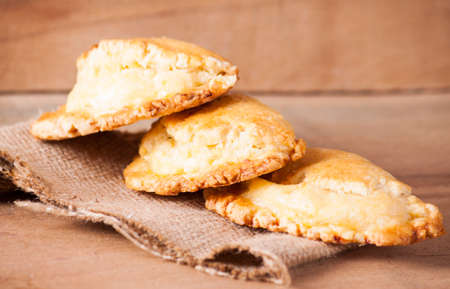 Cookies with cottage cheese on wood background.