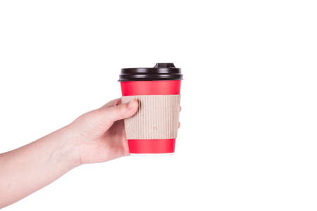 disposable cup: Red disposable cup in hand isolated on white background.