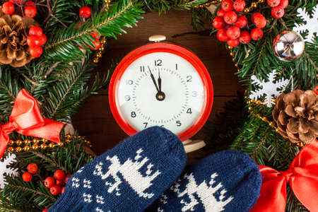 clothe: Christmas wreath and clock clothe up. Greeting card. Christmas background