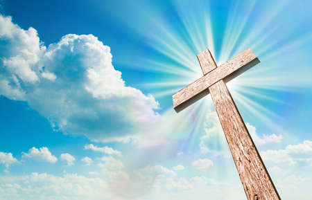 easter cross: Wood cross on blue sky. Christian background. Stock Photo