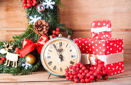 clothe: Christmas wreath and clock clothe up. Greeting card. Christmas background.