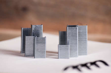 Concept new building. Staples from the Stapler on notebook