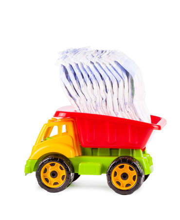 toy truck with a pile of diapers on the back isolated on white background
