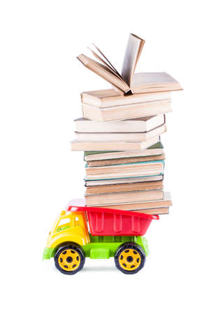 toy truck with a stack of books on the back isolated on white background
