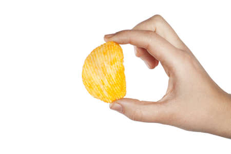 ridged: Potato chips grooved in hand isolated on white background Stock Photo