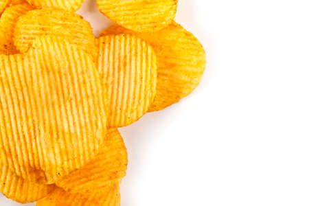 Potato chips grooved isolated on white background Stock Photo