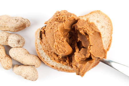 Peanut butter and roasted peanuts isolated on white background