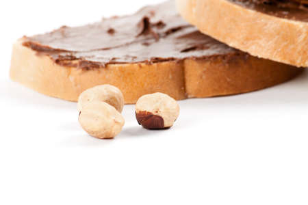 Chocolate nut butter and roasted hazelnuts. Food